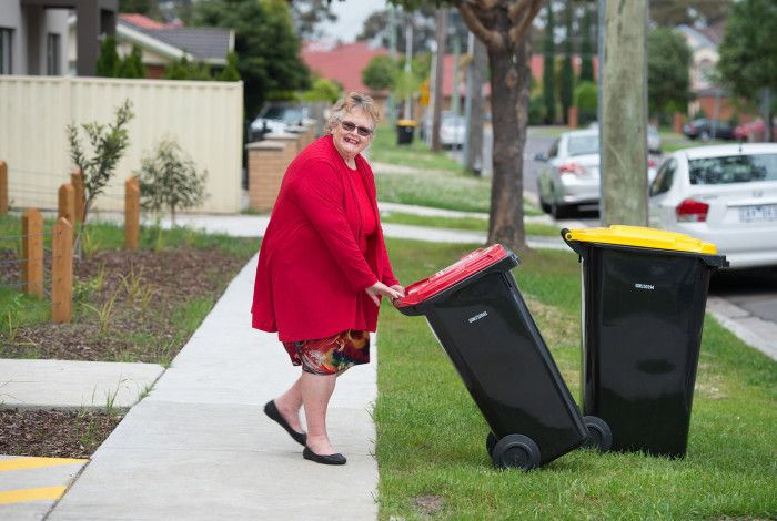 resident putting bin out