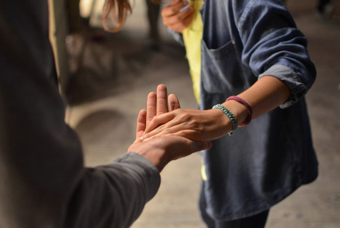 two people connecting via touching hands