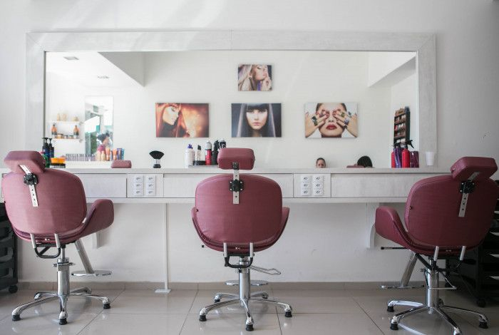 Hairdresser's chairs and mirror set up