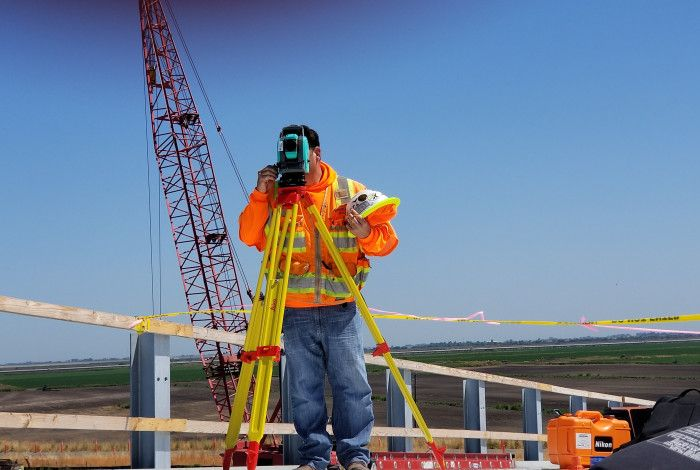 Surveyor on a building site