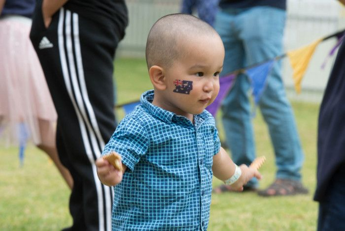 toddler with Australian flag tattoo on his cheek