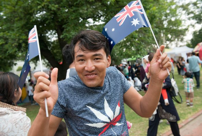 Man with Australian flags celebrating Australia Day