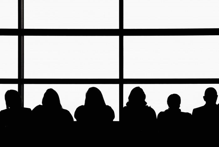 silhouettes of people against a window