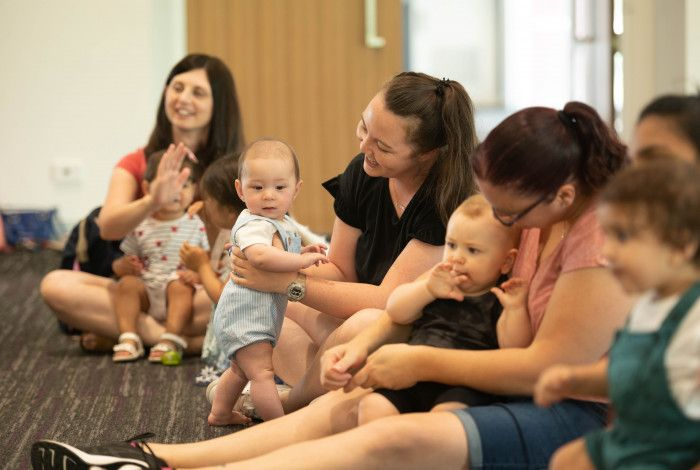 Babies and parents enjoying stories at the library