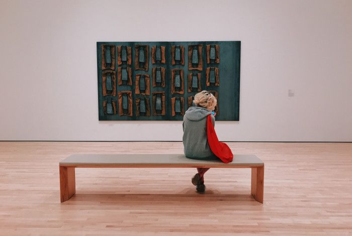 Woman sitting in gallery.