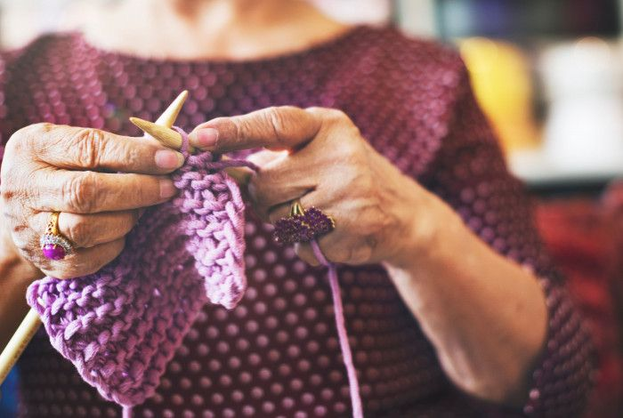 Image of a person knitting