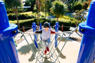 Boy enjoying a playground